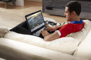 Man Sitting on Couch Using an Inspiron 17 5000 Series Touch Note